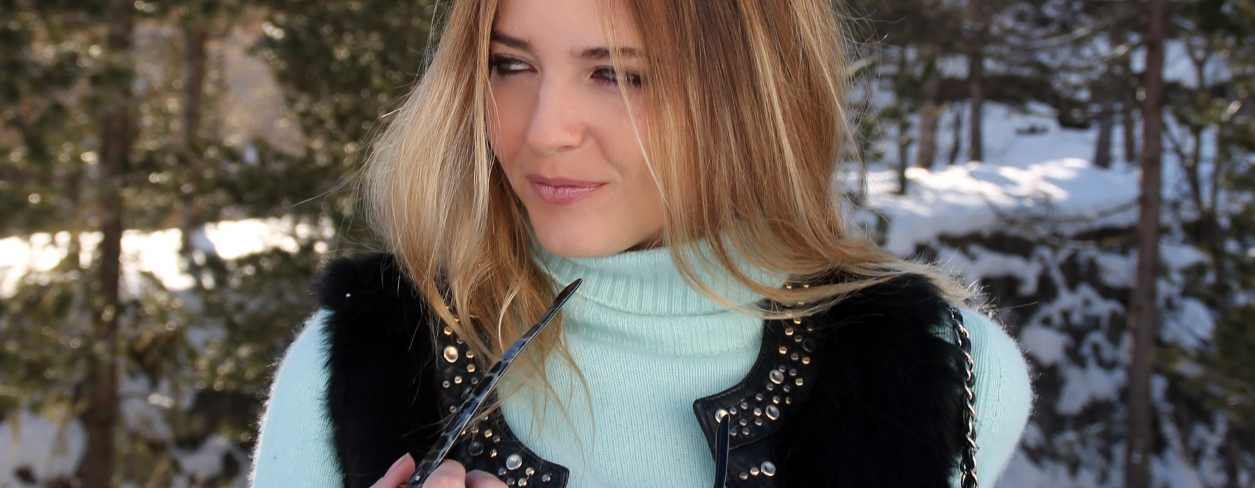 Turquoise Sweater on the Snow