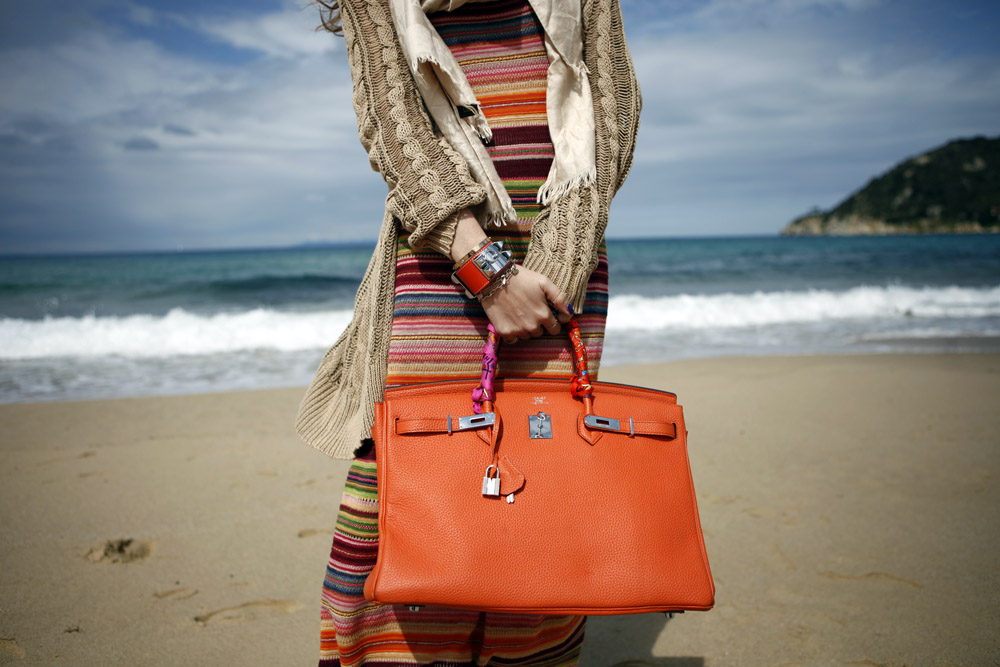 orange birkin in an orange look