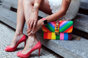 iwatch paired with prada pink shoes and valentino rainbow bag
