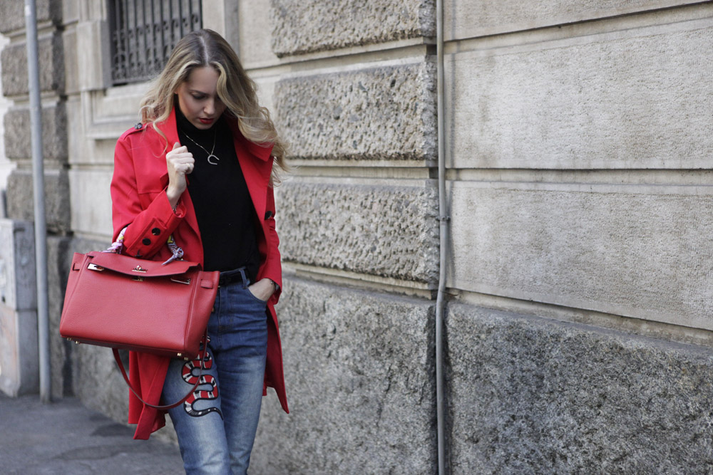 trench and red outfit
